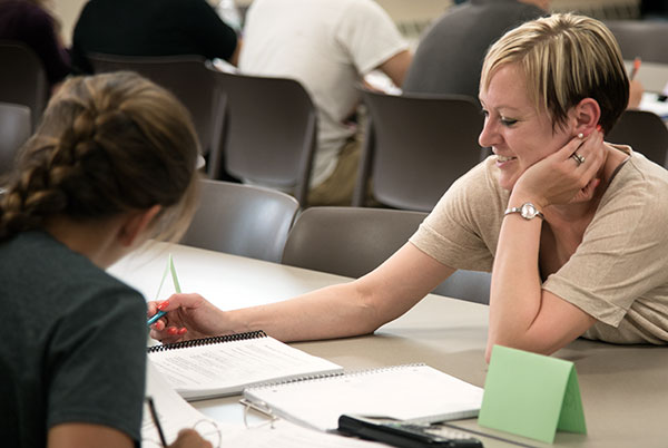 Lisa Lenertz, Biochemistry 501 instructor, explains a problem set to a student.