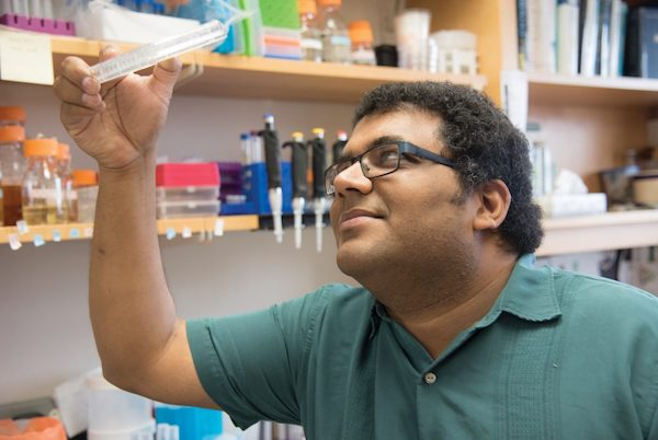 Vatsan Raman looking into Petri dish