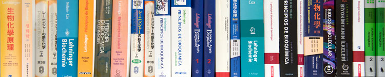 Photo of many editions of the Principals of Biochemistry