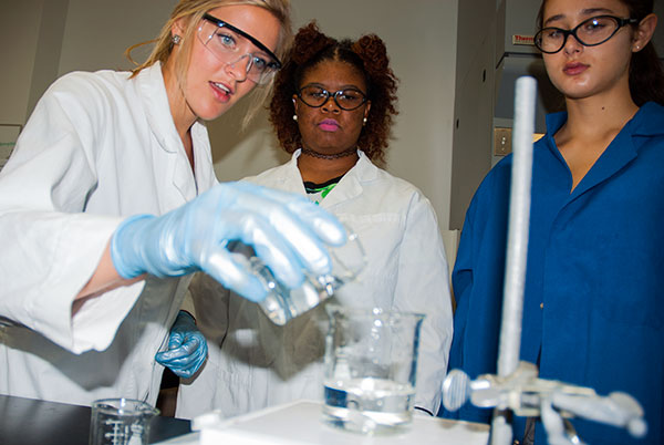 Photo of students doing chemistry