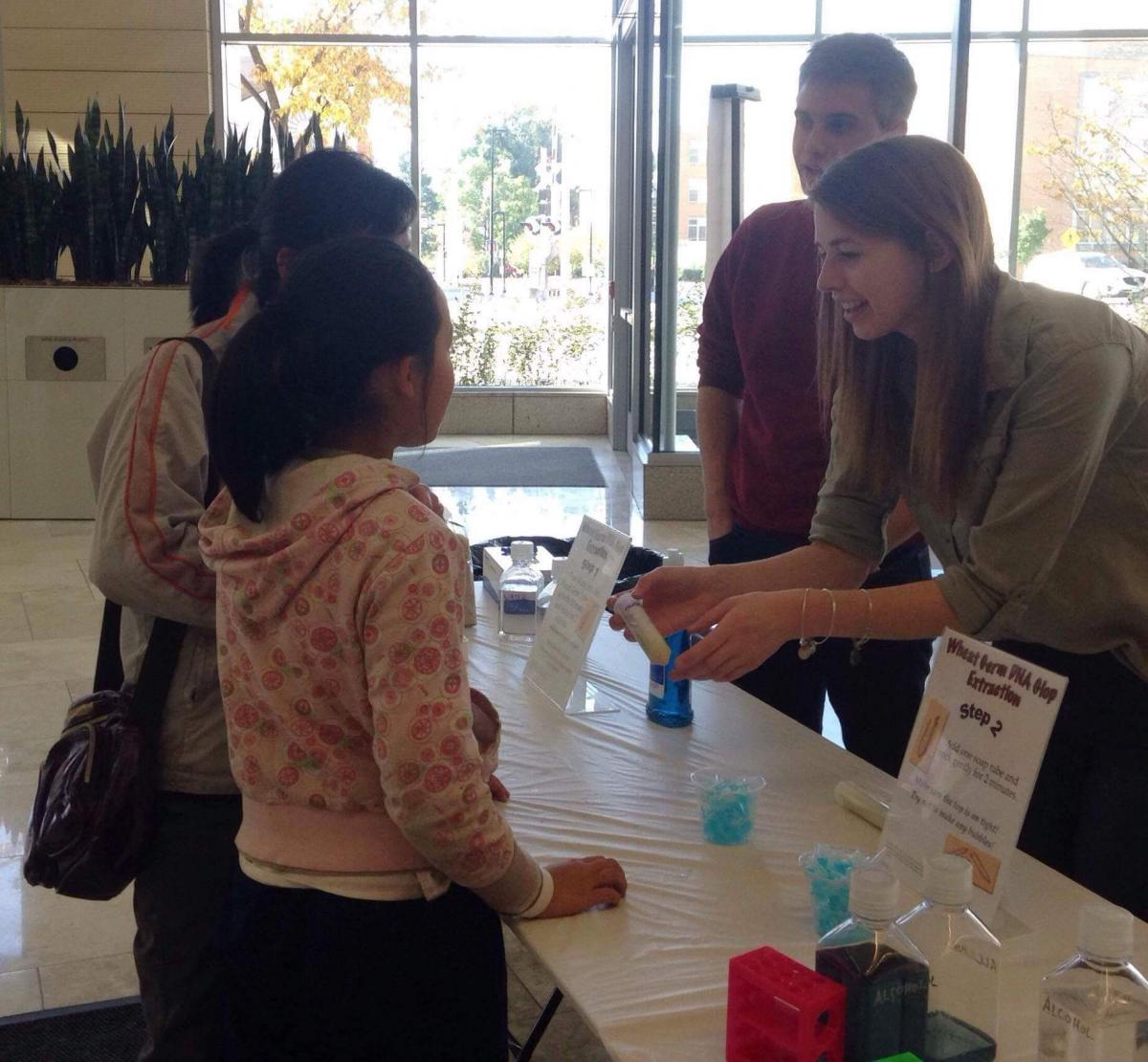 Undergrads in their outreach event at the Wisconsin Institutes for Discovery building.