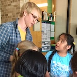 Photo of Ben Ehrlich mentoring elementary school students