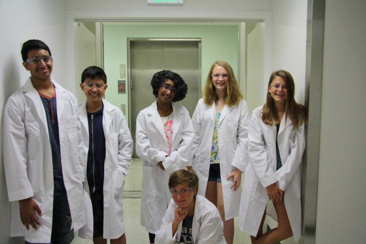 Photo of Project CRYSTAL participants in their lab coats