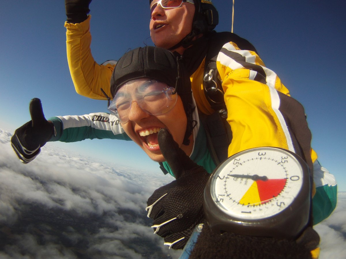 Photo of biochemistry major Meng Lou skydiving