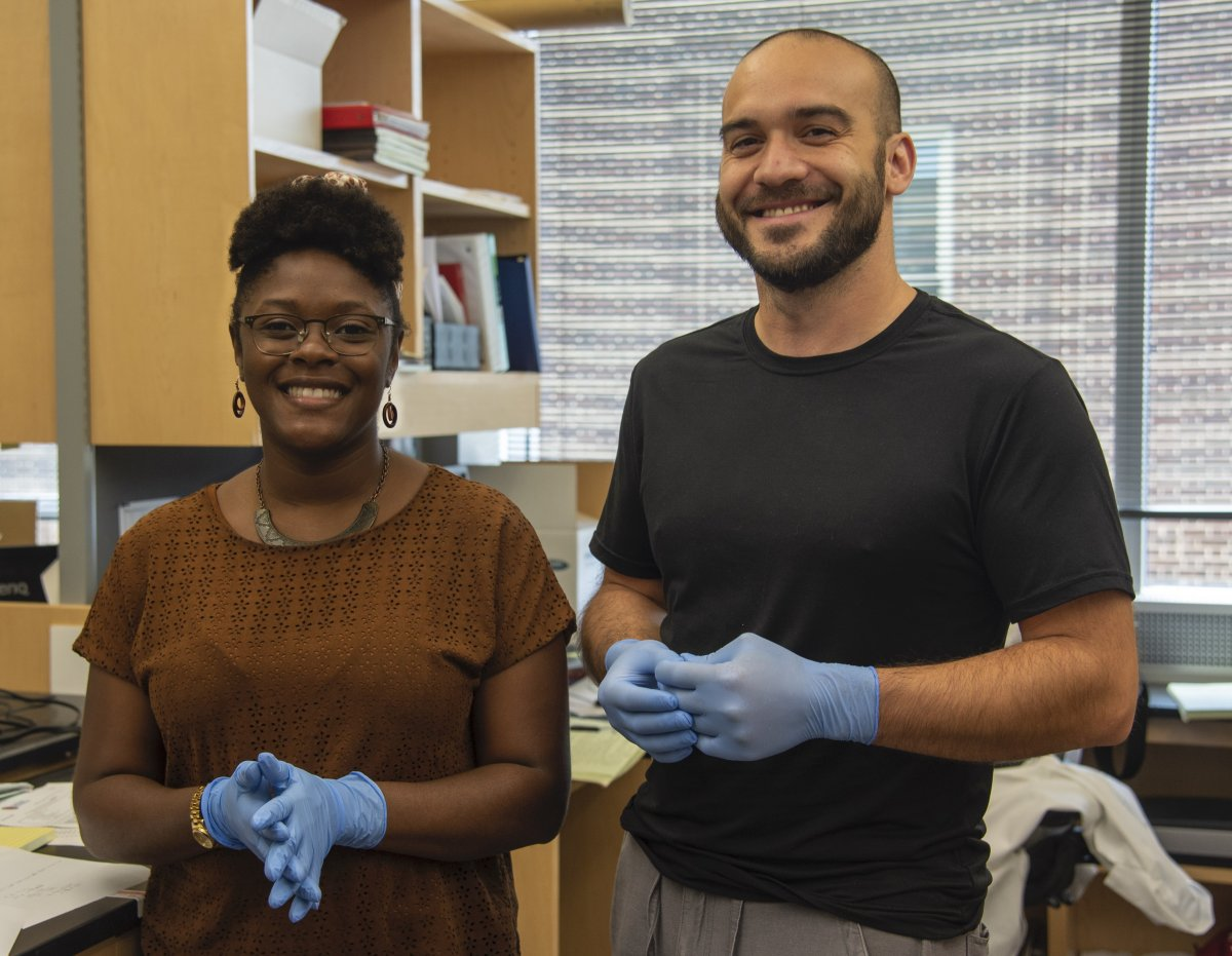 Photo of genetics graduate student Sierra Love and lab manager Josh Paulson