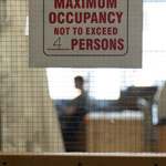 photo of maximum occupancy sign outside a lab